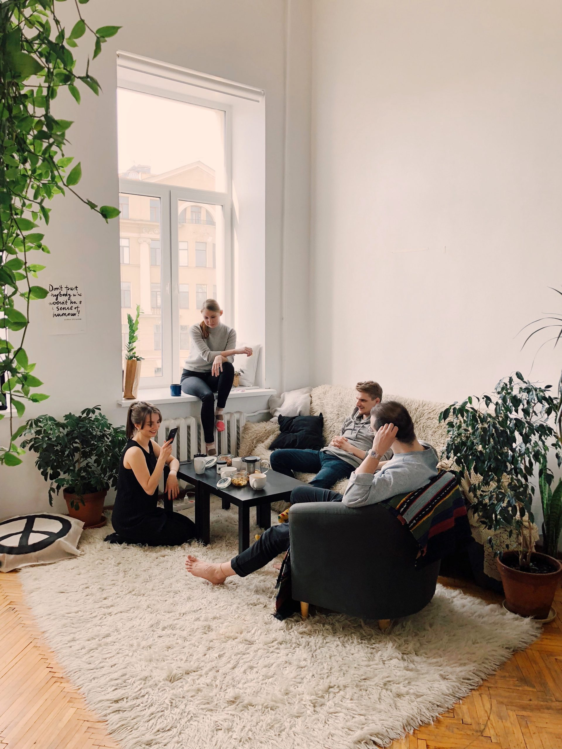 people-gathered-inside-house-sitting-on-sofa-1054974